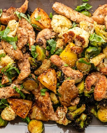 closeup: Greek roasted vegetables and sesame chicken tenders
