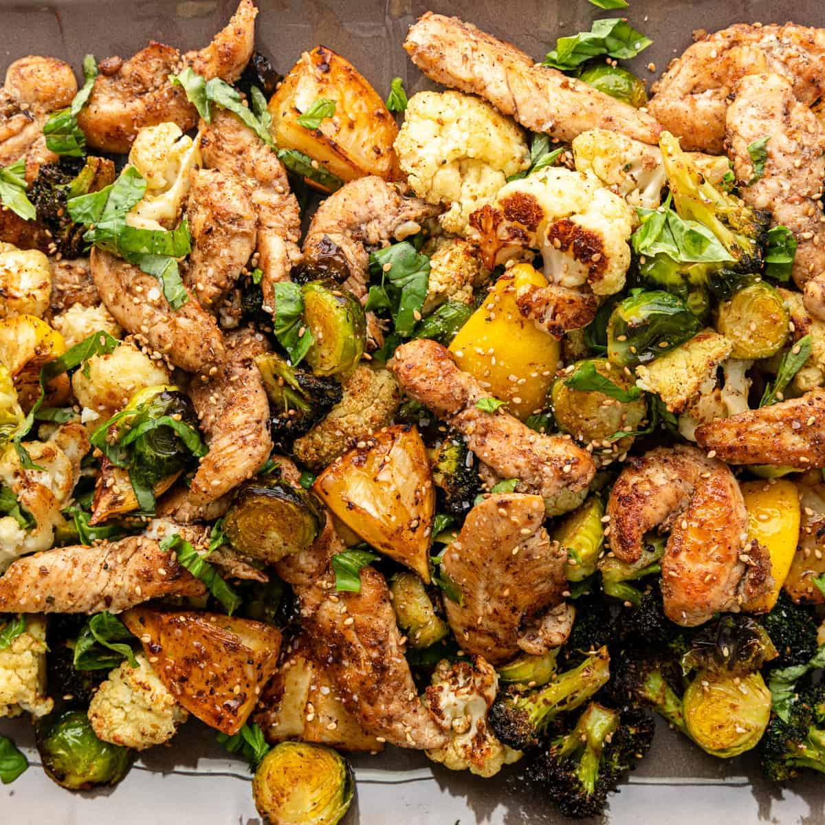 closeup: Greek roasted vegetables and sesame chicken tenders