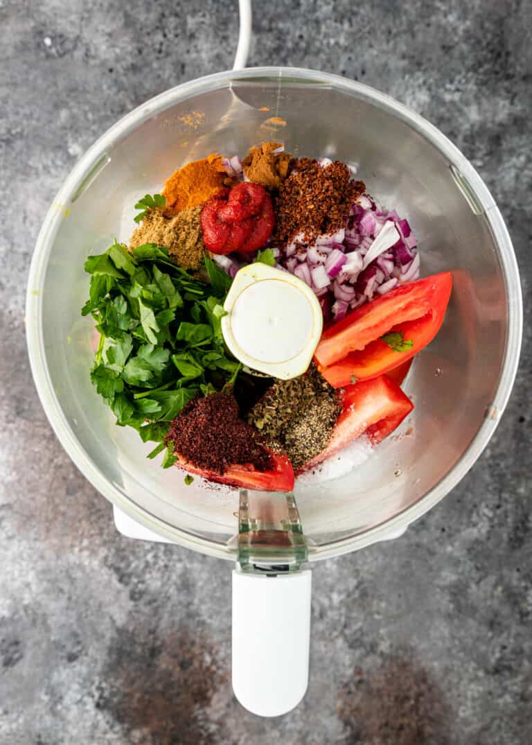overhead image: large mixing bowl with fresh vegetables and spices to make lahmacun