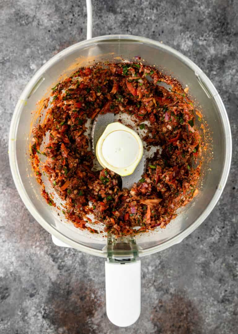 overhead: puree of tomato paste, vegetables and seasonings in mixing bowl