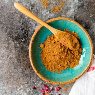 small bowl of Persian spices for Advieh spice blend