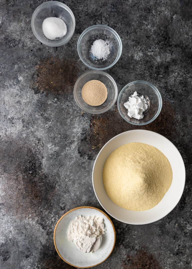 overhead image: bowls of semolina flour, yeast, salt, and spices to make Moroccan pancake batter