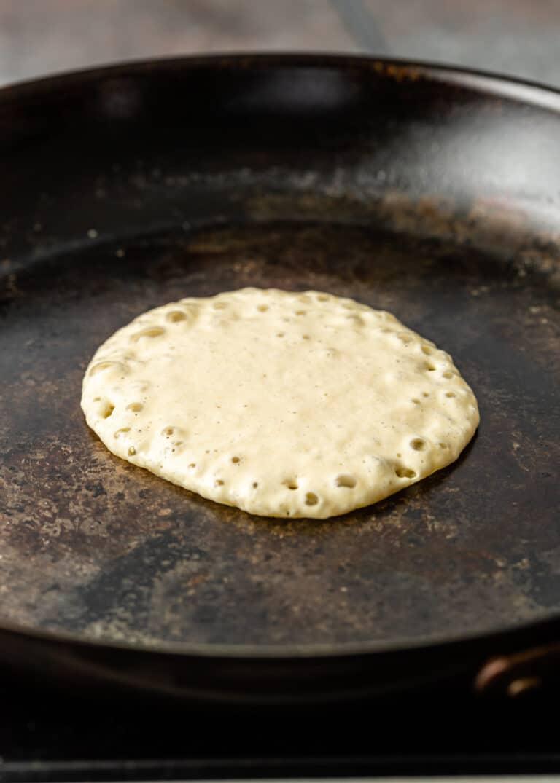 cooking pancake batter in skillet