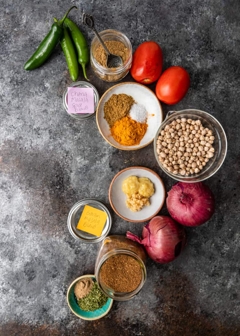 spices, dry chickpeas, roma tomatoes and other ingredients to make chana masala instant pot curry recipe