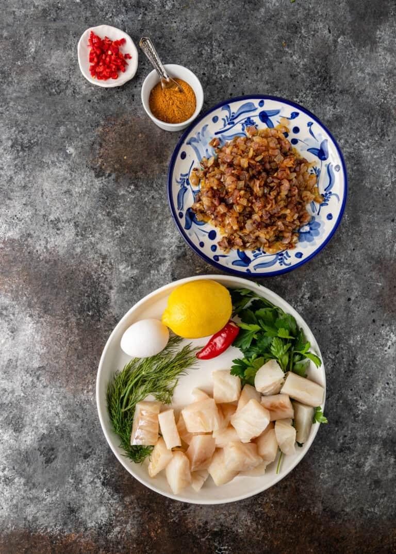 ingredients on plates for fish kofta meatballs