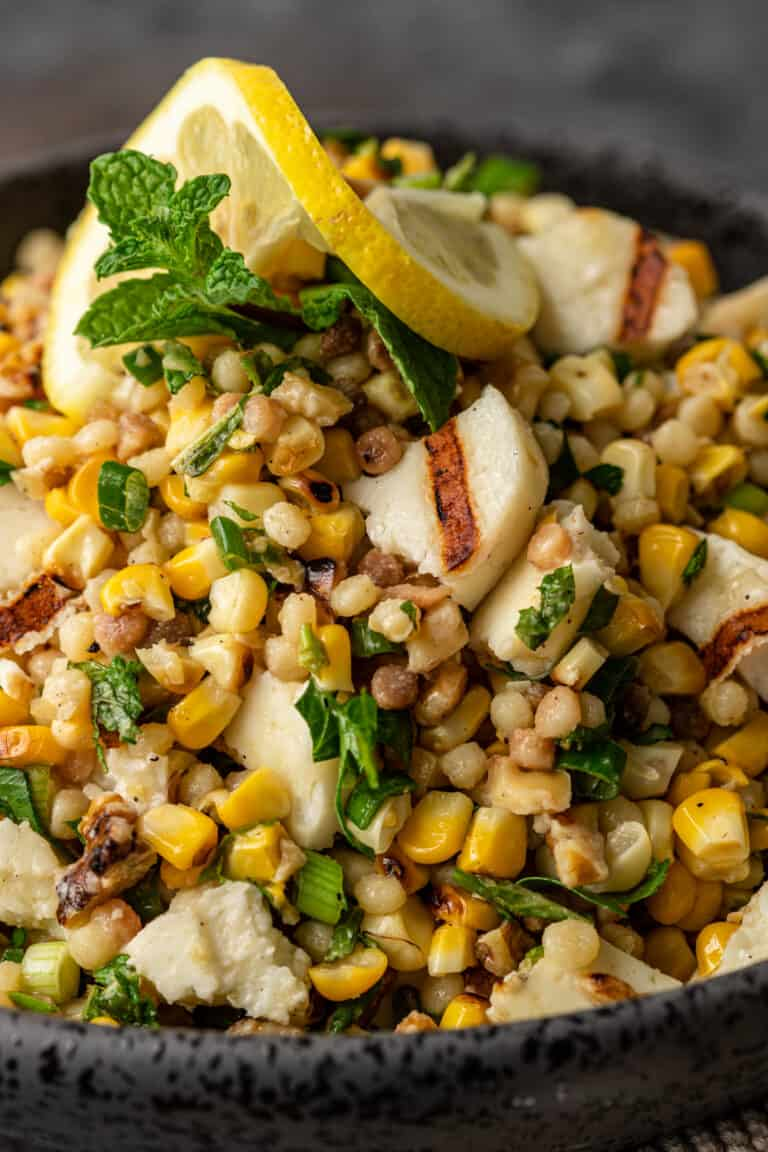 overhead image: salad of grilled halloumi salad with corn niblets and fregola pasta
