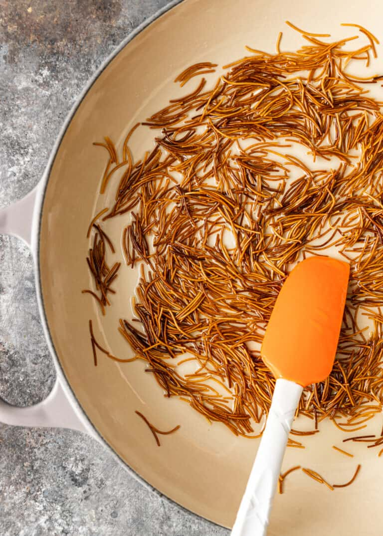 golden brown vermicelli toasting in skillet