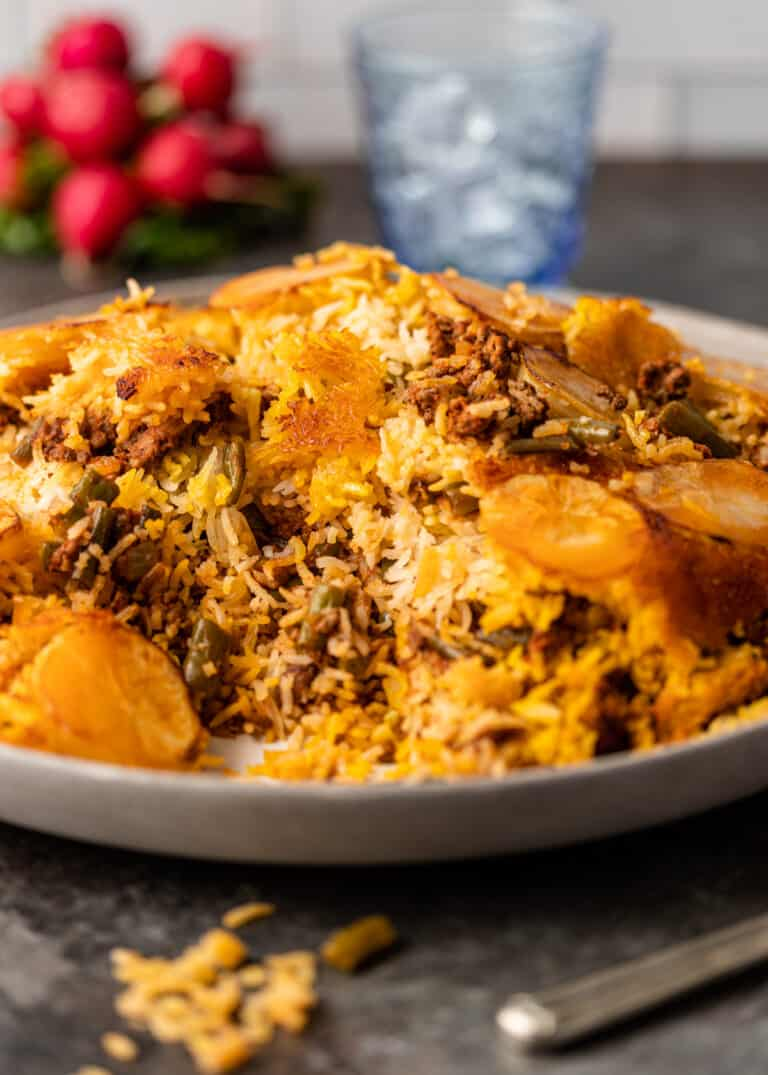 side view: Iranian rice dish with ground beef and green beans