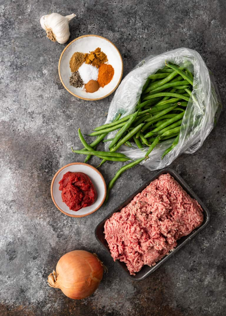 overhead: ingredients for lubia polo recipe on gray marble counter