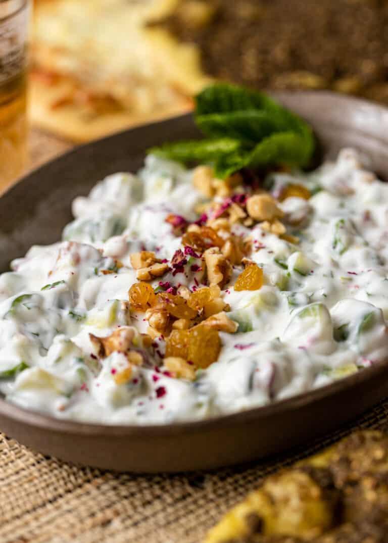 closeup image of Persian cucumber yogurt salad in brown bowl