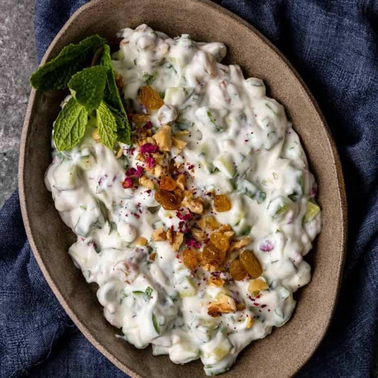 overhead image: bowl of Iranian mast o khiar (cucumber salad)