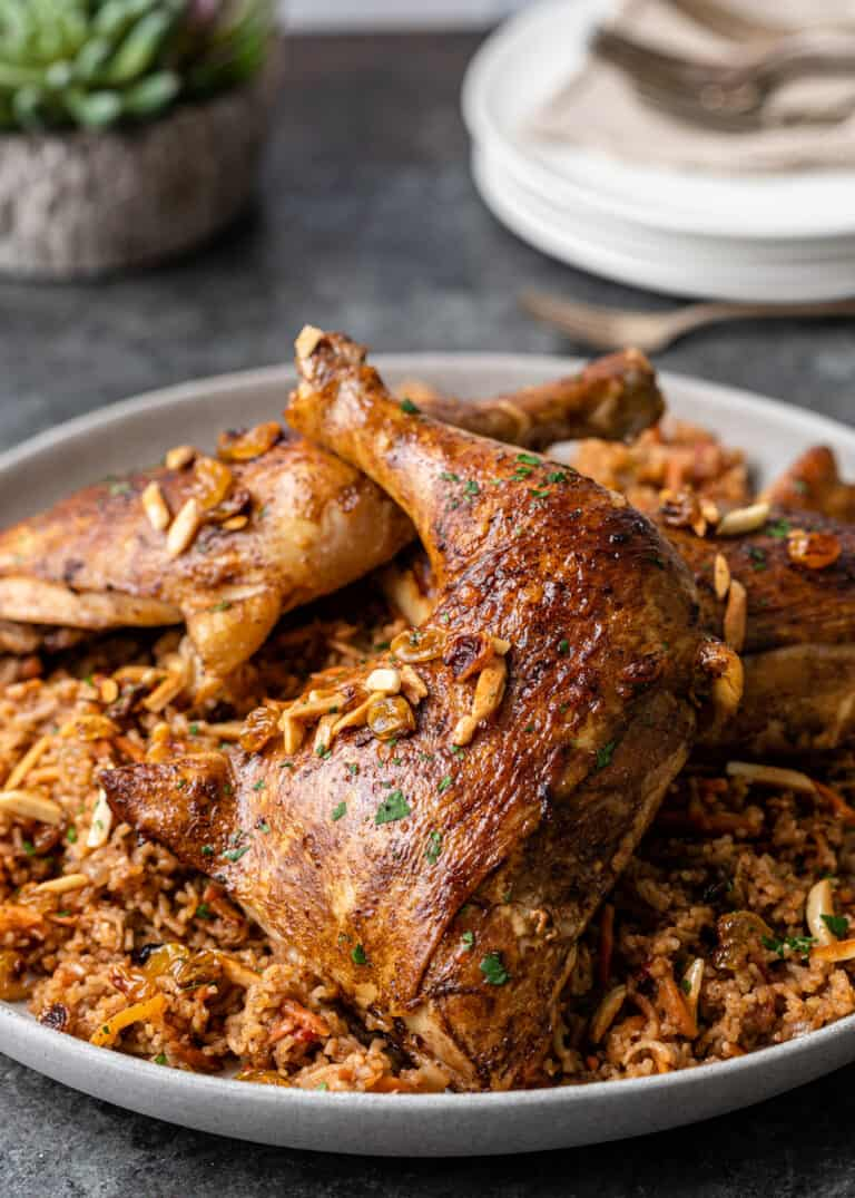 side view: platter of kabsa chicken and rice