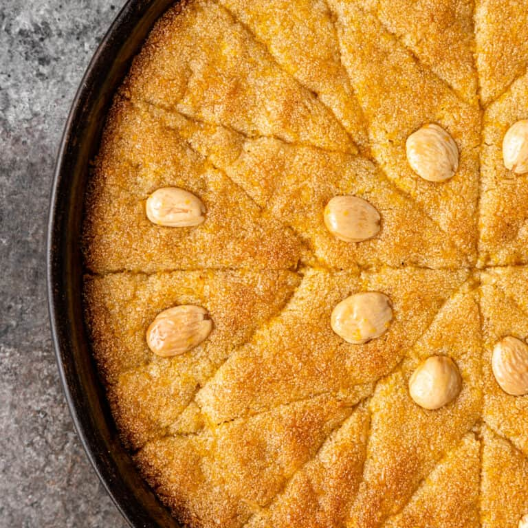 overhead image: basbousa cake topped with marcona almonds