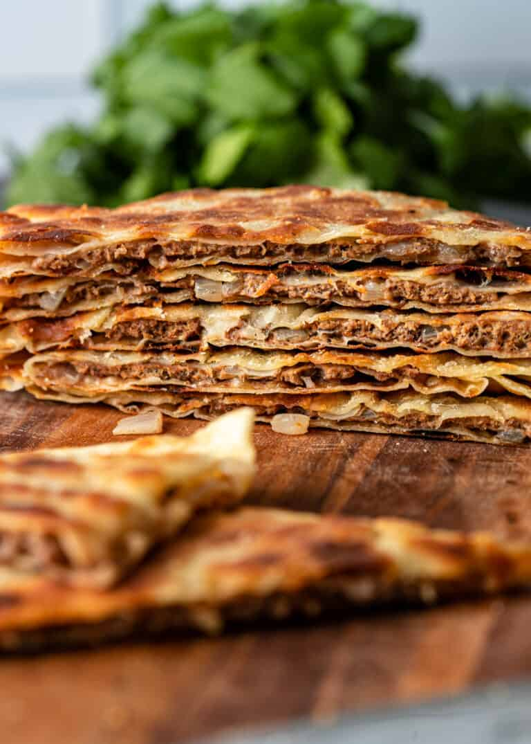side view: stack of thin stuffed flatbreads