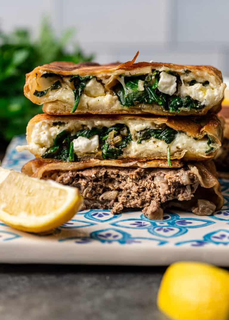Turkish street food flatbreads filled with ground lamb and potatoes, and spinach and feta