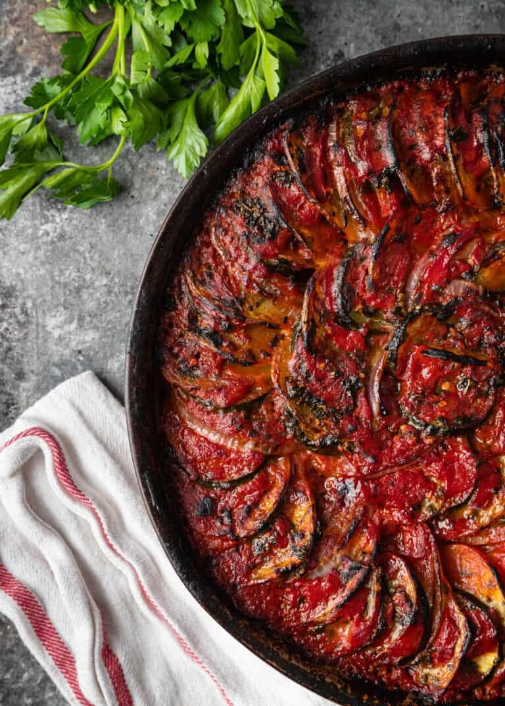 overhead: Mediterranean vegetables arranged in round casserole dish