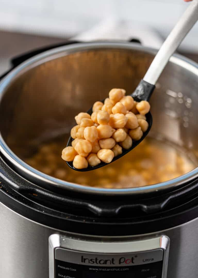 Instant Pot garbanzo beans on large serving spoon