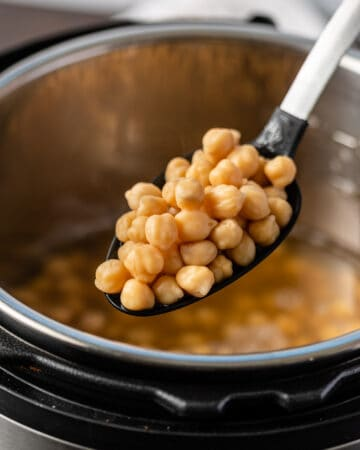 Instant Pot chickpeas on slotted spoon