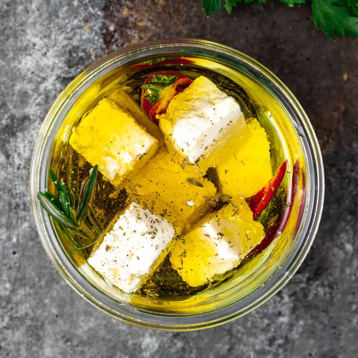 close up image: feta cheese appetizer in glass jar