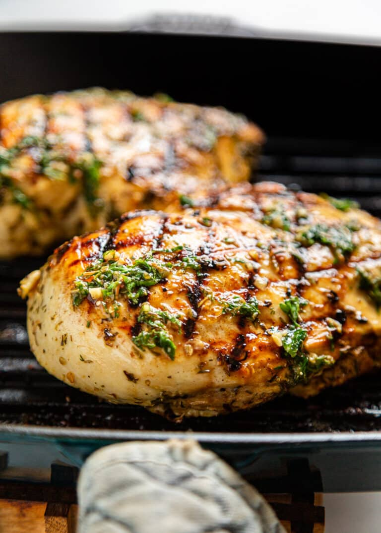 closeup of marinated Greek chicken on the grill