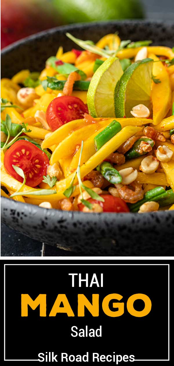 titled image shows closeup of salad with thailand mangoes, cherry tomatoes, green beans, and peanuts