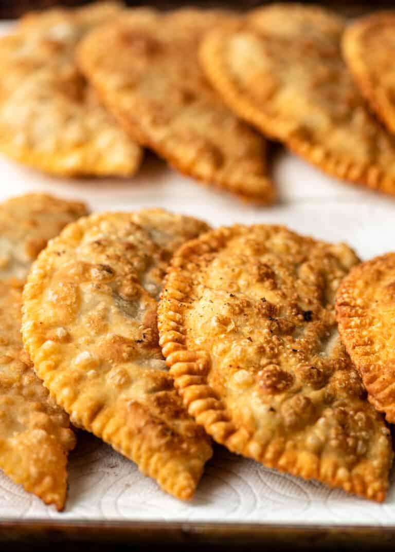 close up image of golden brown, fried chebureki