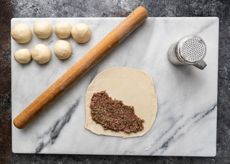 overhead image: ground beef filling on pastry dough for meat hand pies