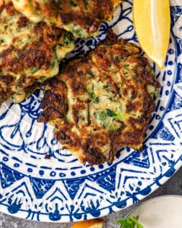 overhead closeup photo of Kolokithokeftedes zucchini patties