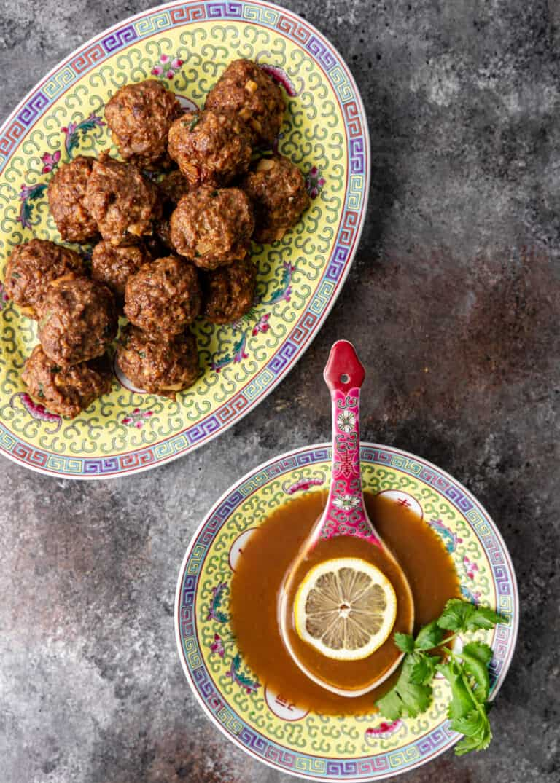 dish of creamy lemon sauce next to platter of ground chicken meatballs