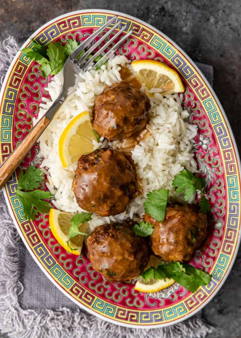 overhead image: Asian ground chicken meatball dinner with white rice
