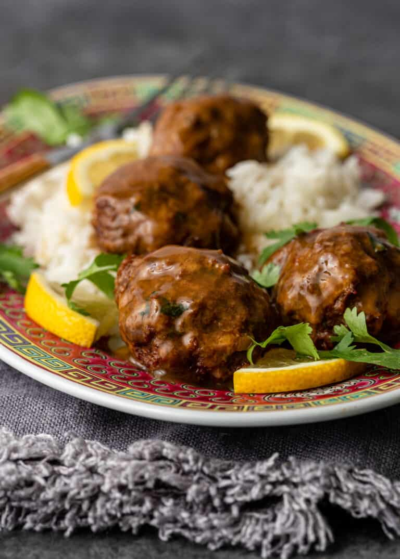 platter of lemon cilantro chicken meatballs served over rice