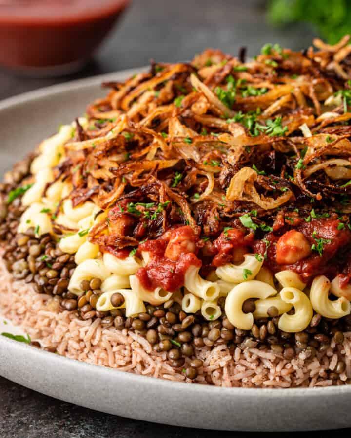 Egypt's national dish, koshari, on white serving platter