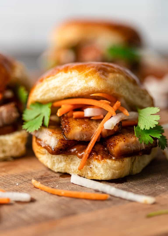 close up image: fried pork belly slider sandwich