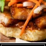 titled image for Pinterest shows close up of an Asian pork belly sandwich