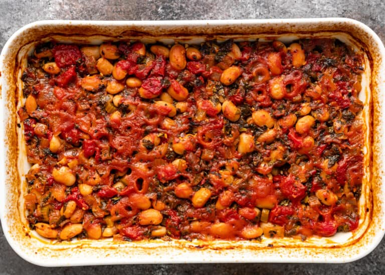 overhead image: side dish of baked legumes in tomato sauce