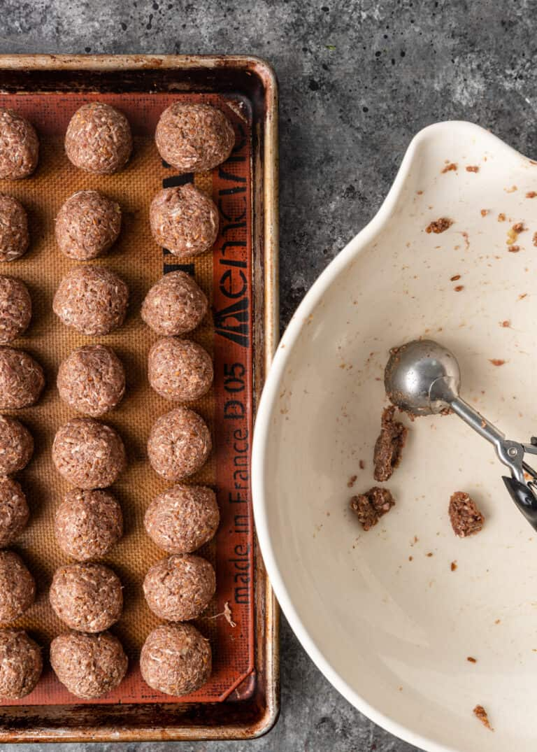 overhead: kibbeh nayeh lined up on sheet pan