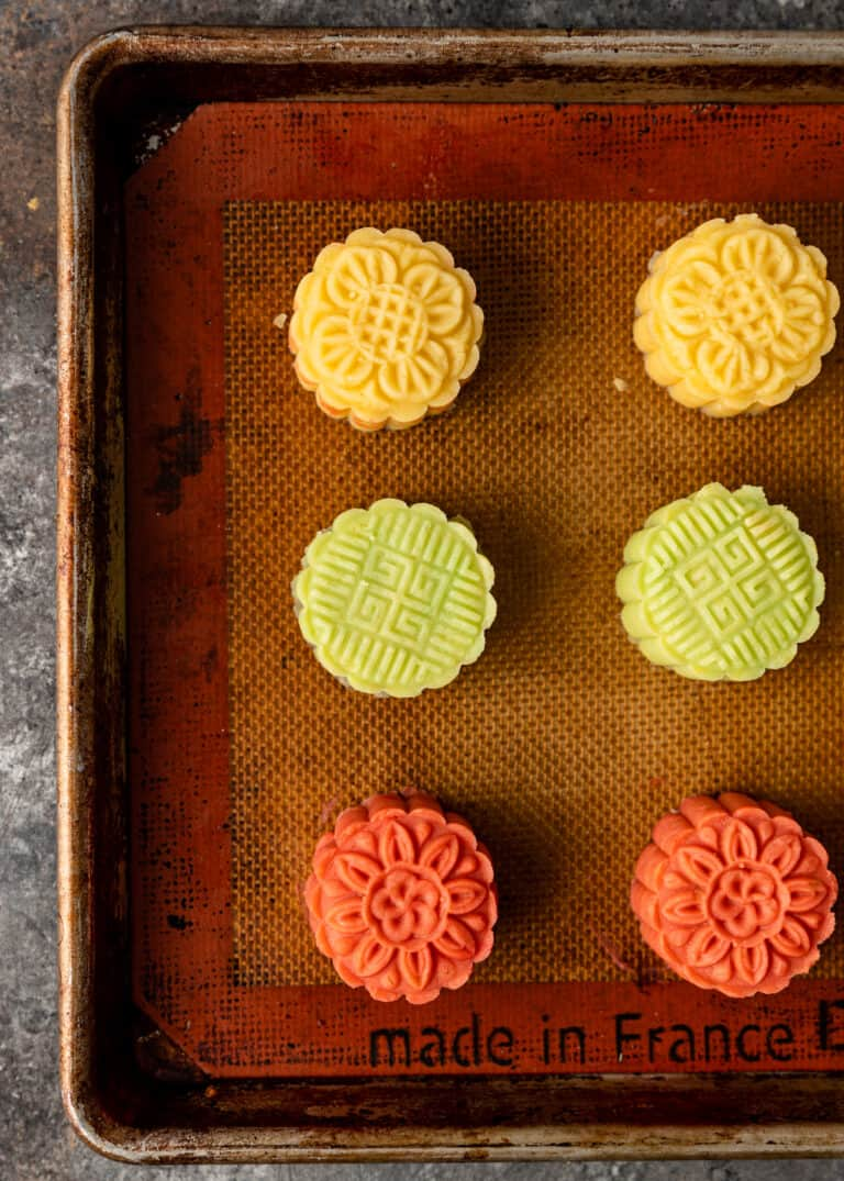 overhead image of desserts on baking sheet made with Chinese moon cake molds