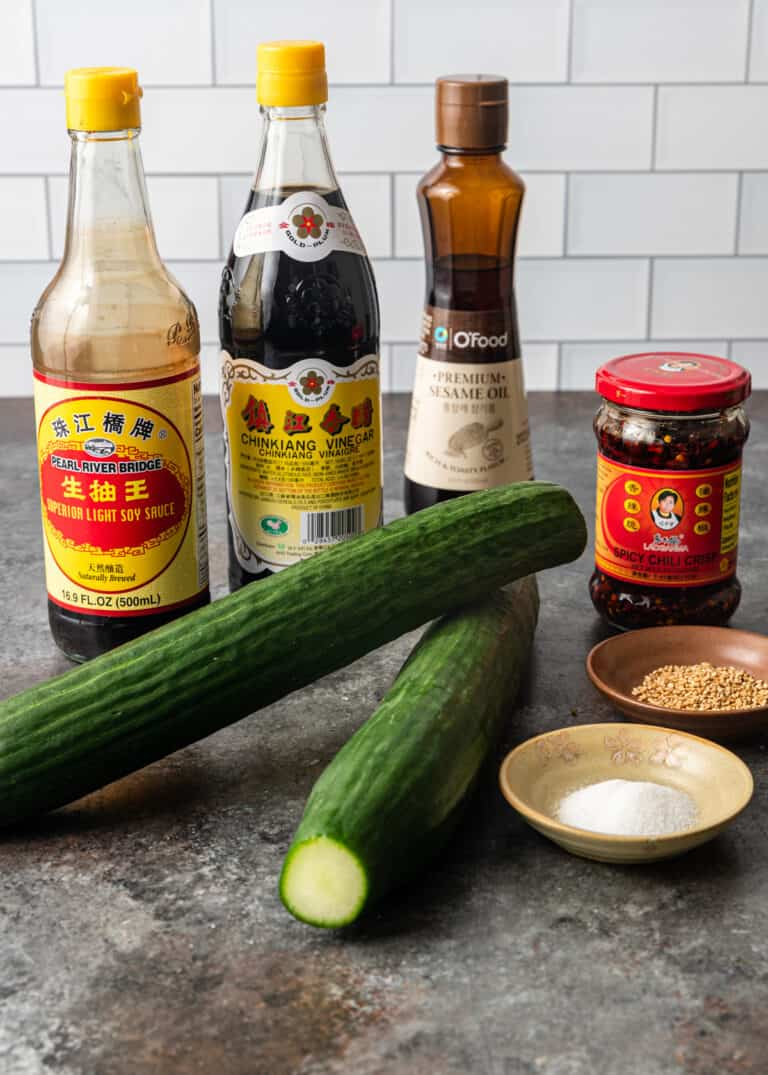 soy sauce, sesame oil,, long cucumbers and other ingredients for Chinese cucumber salad recipe