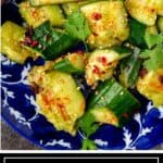 titled image for Pinterest shows bowl of Chinese cucumber salad drizzled with spicy chili crisp