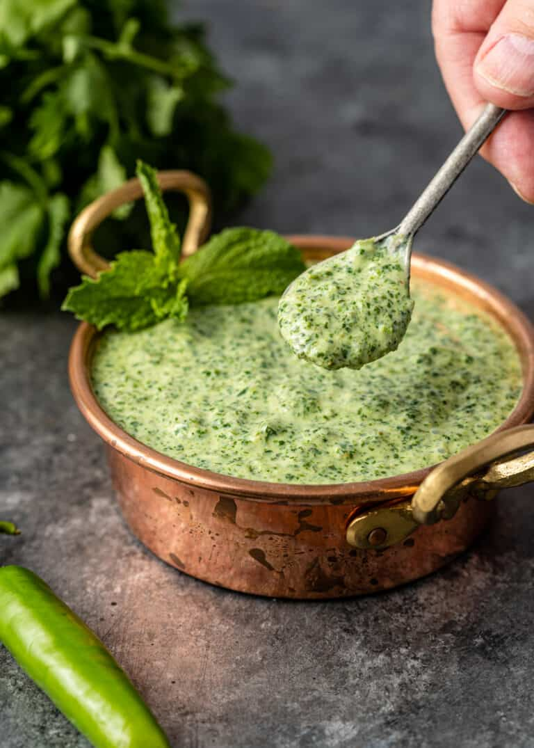 spoonful of Indian mint sauce above bowl