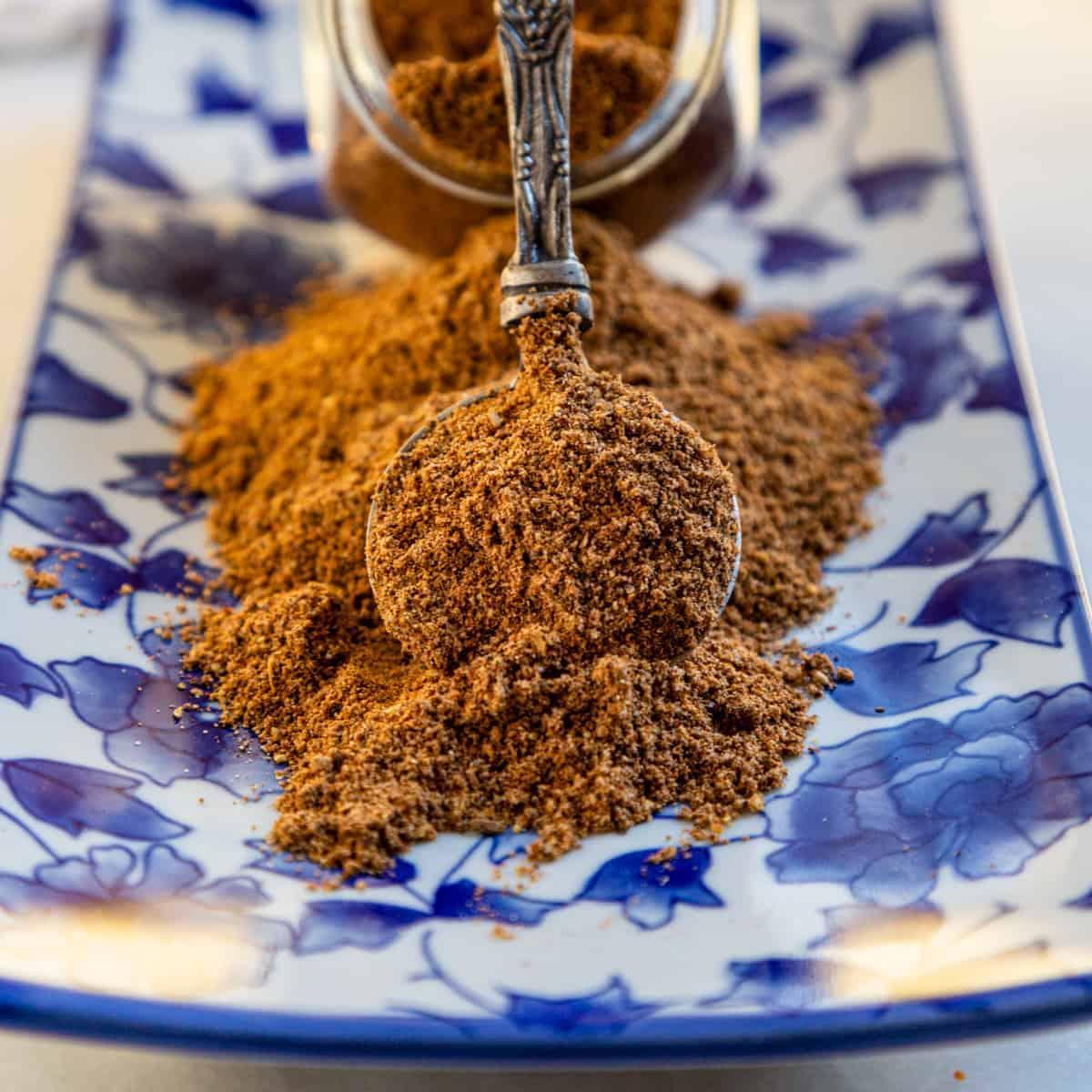 close up image: ground szechuan seasoning on spoon