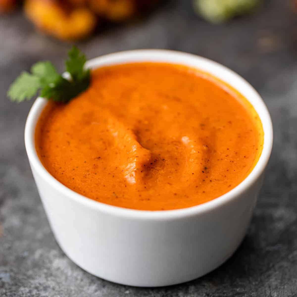 tomato chutney in small white bowl