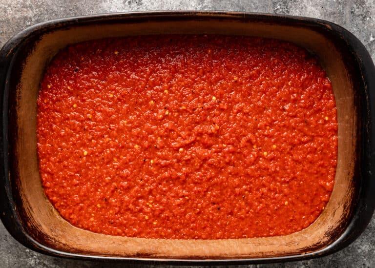overhead: casserole stoneware dish of red sauce