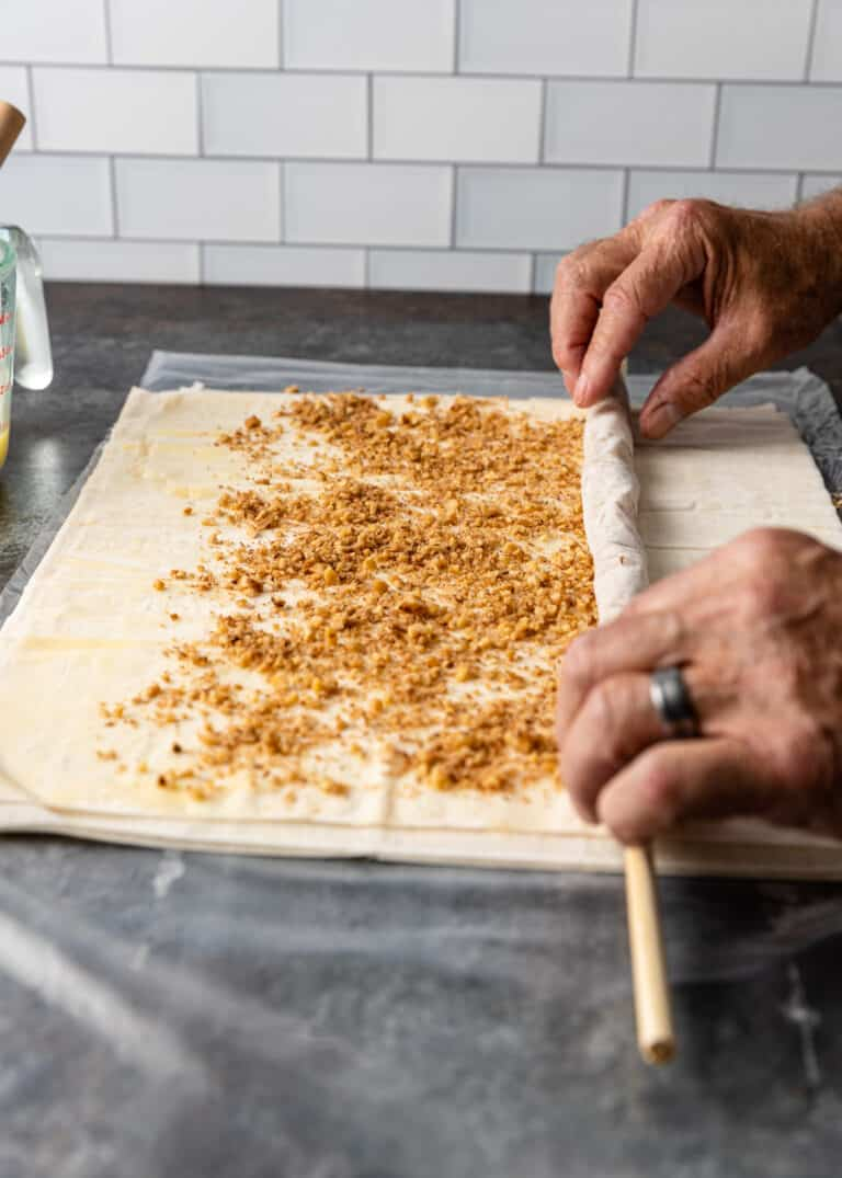 rolling phyllo pastry with baklava filling