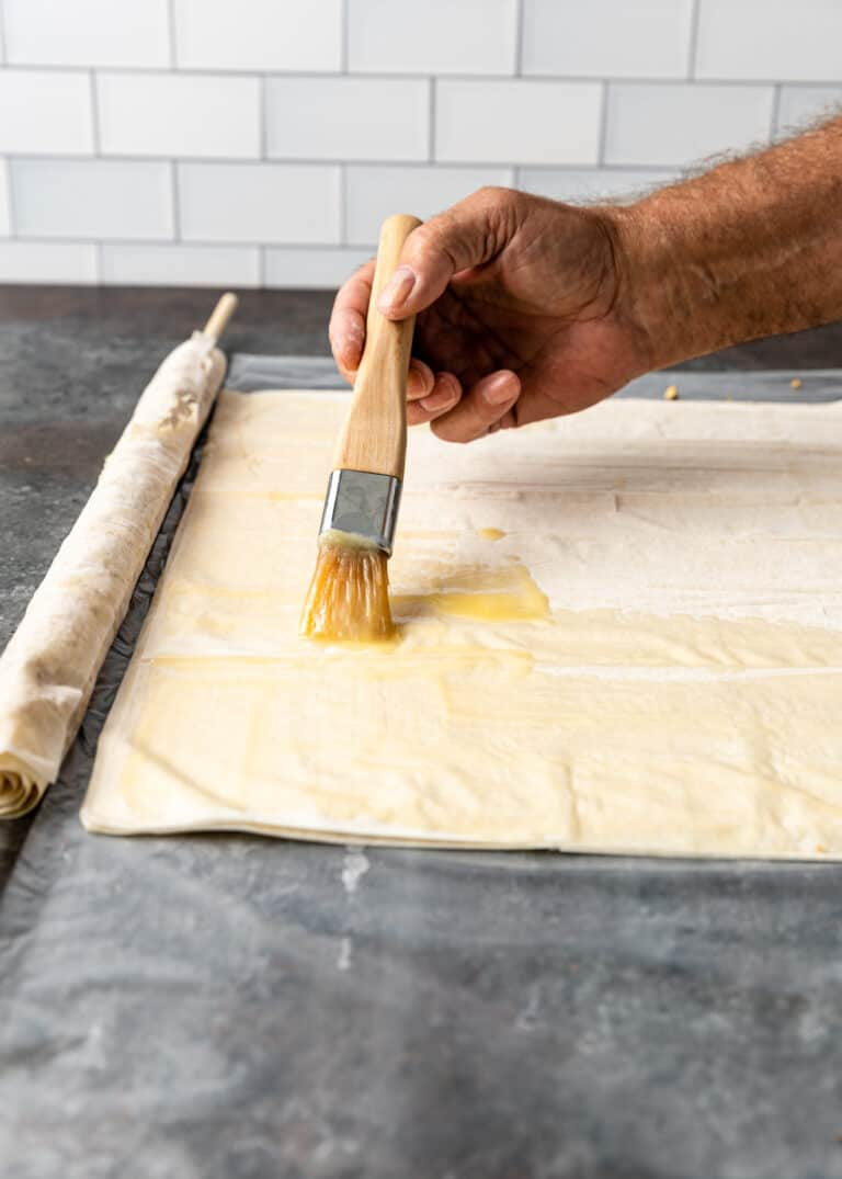 brushing phyllo dough with butter for Greek baklava