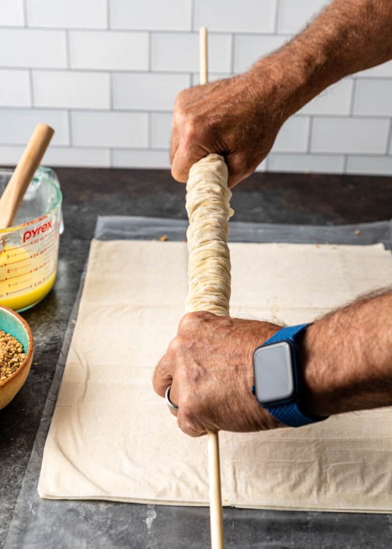 rolling phyllo pastry for Greek dessert