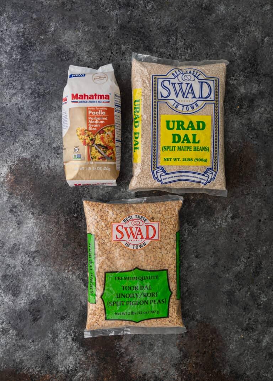 overhead: packages of urad dal, split pigeon peas and paella rice