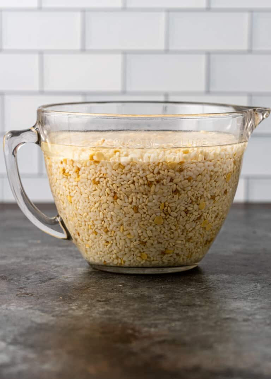 split lentils and split chickpeas soaking for masala dosa recipe