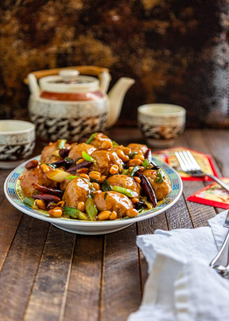 dish of kung pao Asian chicken meatballs on table top
