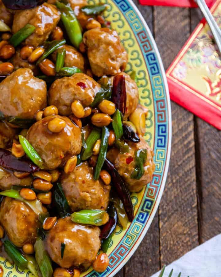 kung pao Asian chicken meatballs on Oriental style platter